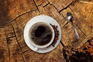 A cup of black coffee.