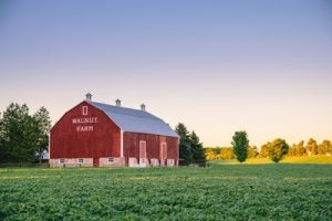 Buying storage units – such as this barn on a green field – can turn you a profit, if you know what you're doing