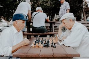 These two senior guys playing chess wish to retire to Florida in order to have some peace and quiet