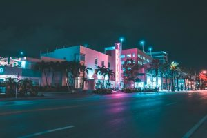 night shot of street with palm trees
