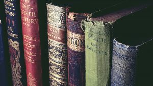 A line of damaged book covers