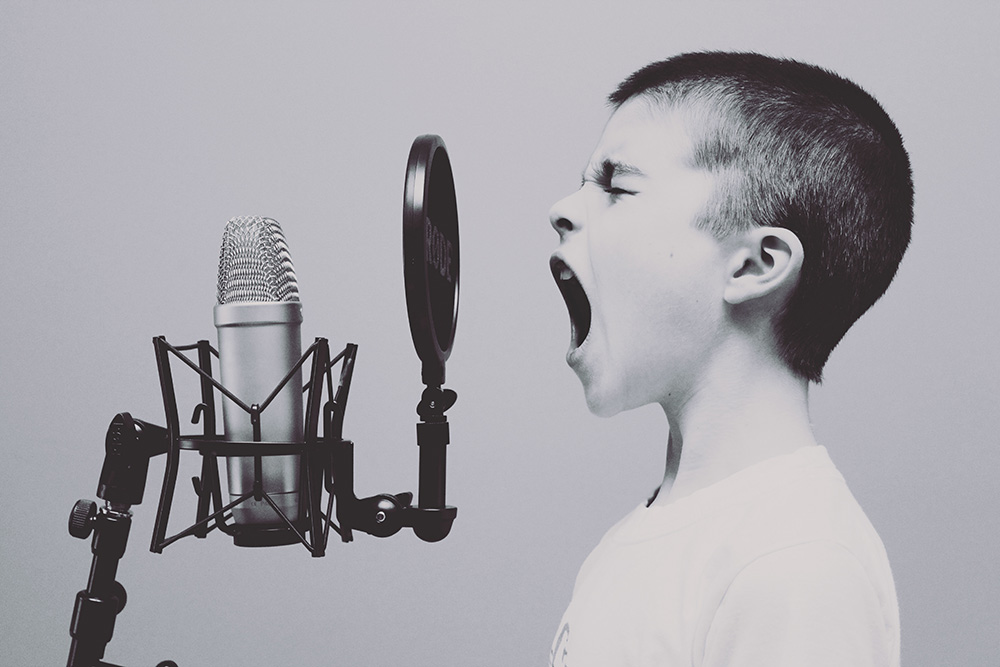 A kid yelling at a microphone