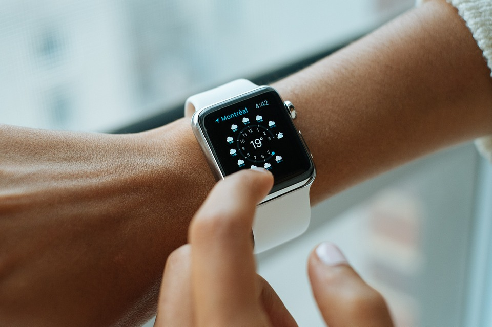 A woman looking at her smartwatch.