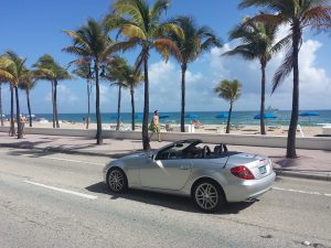 A car next to a beach in Miami, one of the best FL cities for millennials.