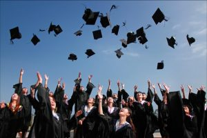 College grads throwing their graduation hats in the air