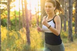 A woman jogging and staying healthy while moving