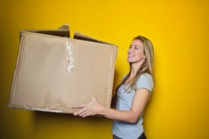 A woman holding a damaged box