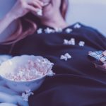 a girl eating popcorn, representing Top tips for settling into your new home
