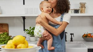 Woman with a toddler in the kitchen