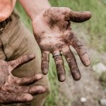 a pair of dirty hands