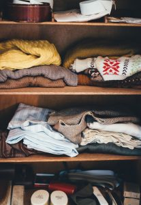 Unsorted clothes you need to sort out before you store your winter clothes after moving to Florida