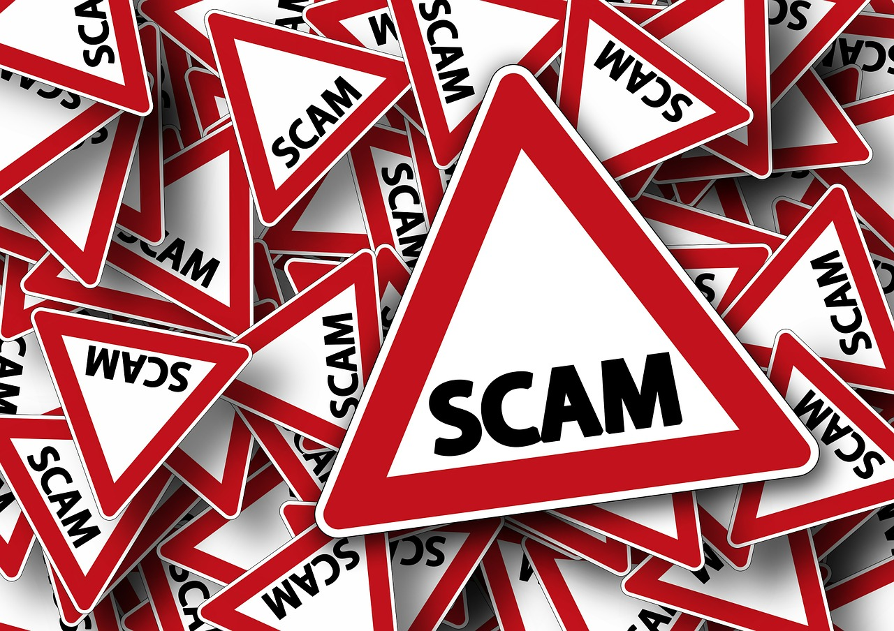 Signs that say scam