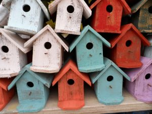 a bunch of stacked bird houses