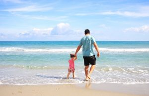 Father and daughter on the beach as one of the reasons why moving to Florida in 2020 is a good idea