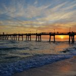 A pier during sunset.
