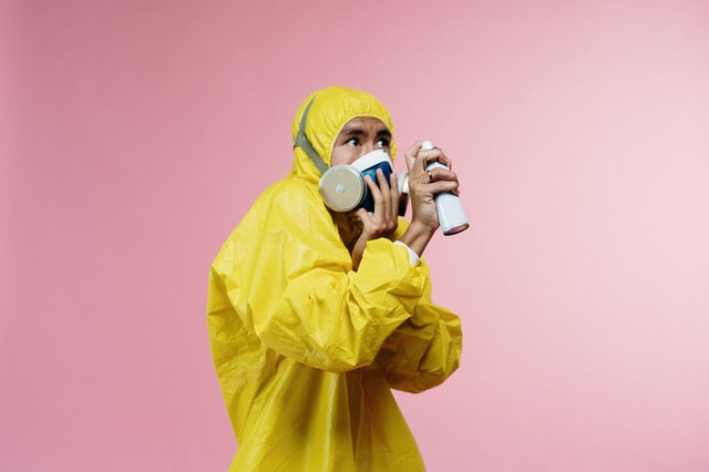 a man wearing yellow protective suit