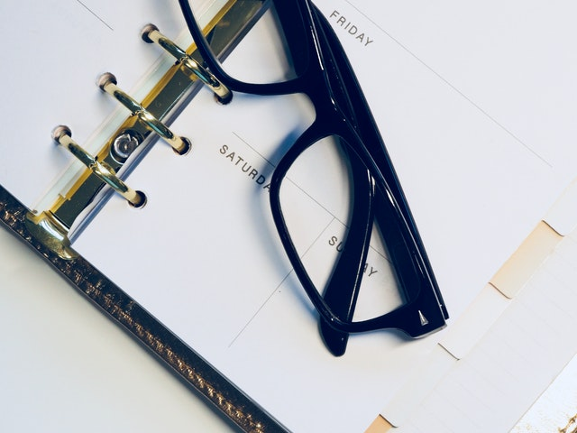 glasses on the planner