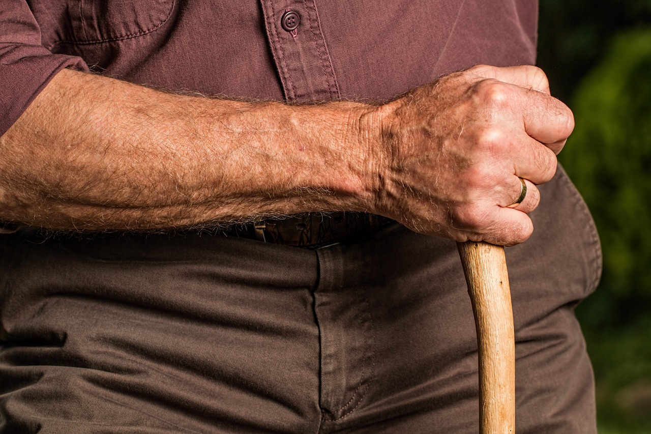 elder person holding a cane