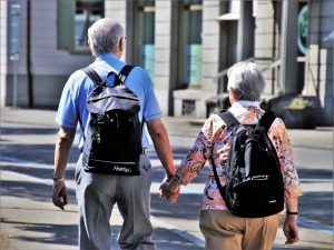 elders holding hands after reading Packing guide for seniors