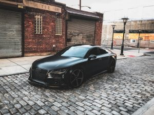 Black Audi in front of a garage