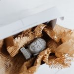 Buddha in a box waiting for you to pack your precious items for storage