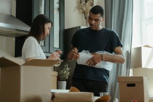 Man and a woman packing