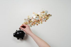 Black piggy bank with coins when you cut down the costs of relocating to Florida