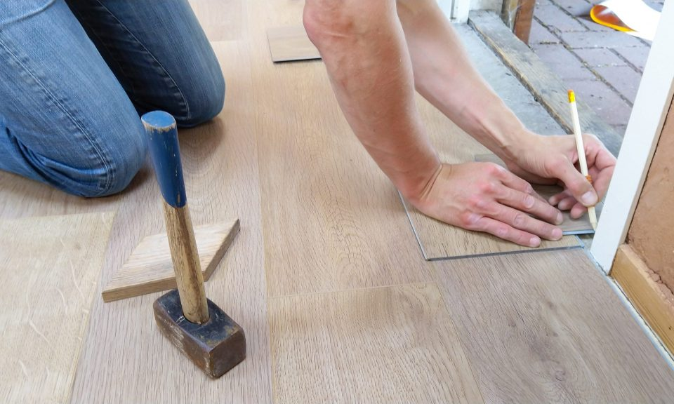 person changing the flooring as a part of budget-friendly renovation ideas