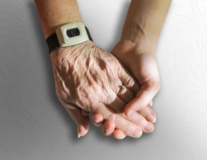 holding hands with an elder