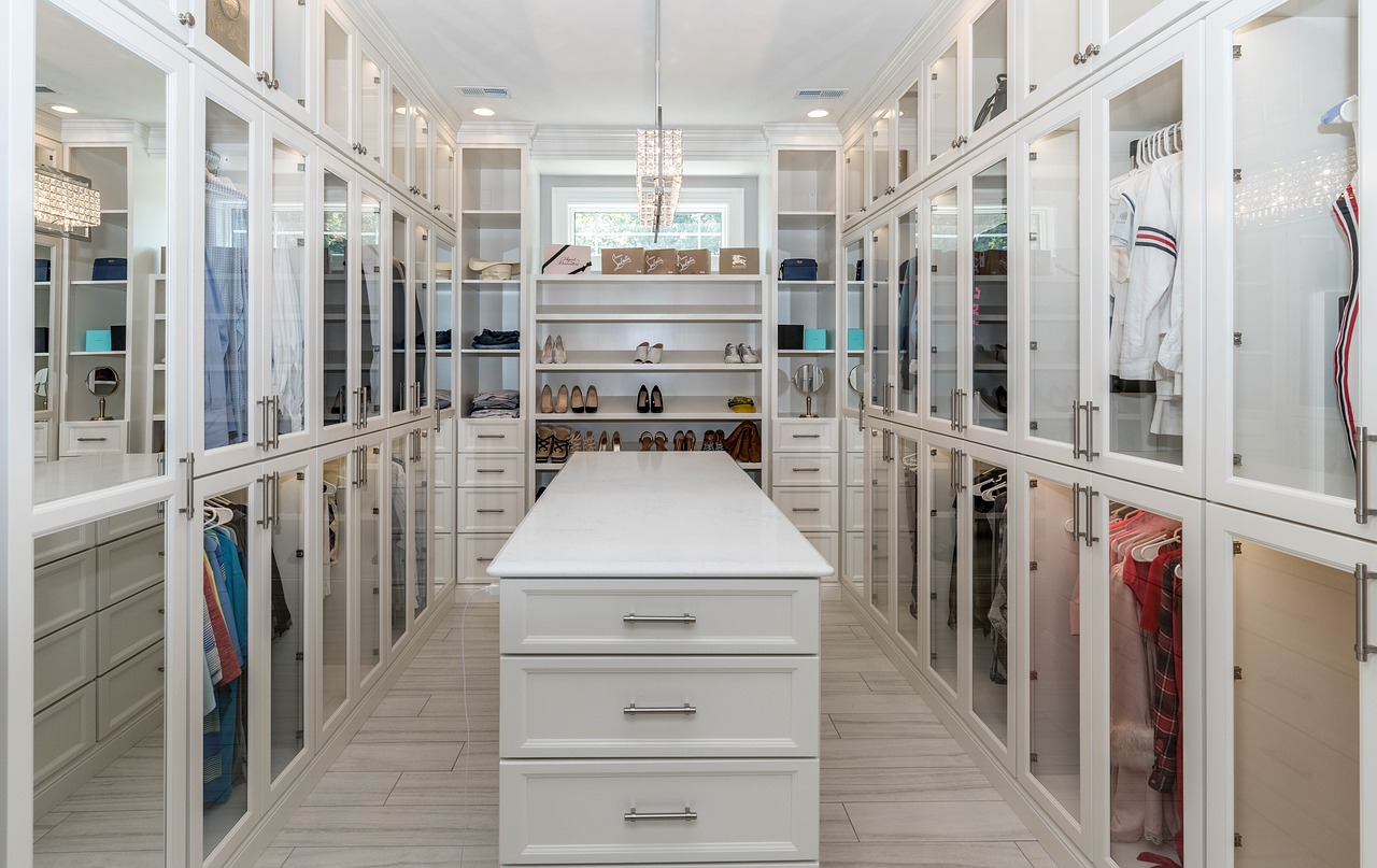 Declutter your walk-in closet before you move and you will get a perfectly organized wardrobe